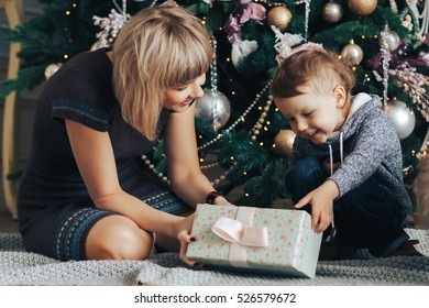 Mom and son open Christmas gifts