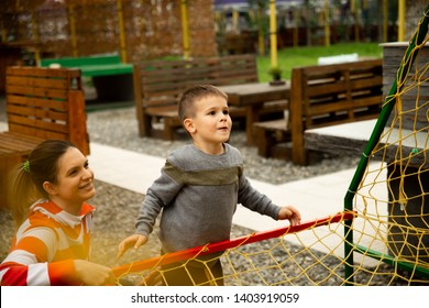 Mom and son play basketball