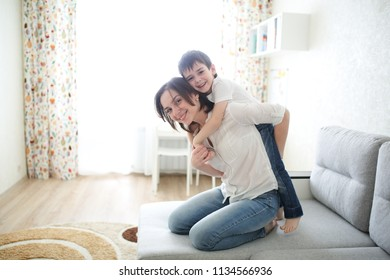 Mom and son together, gentle hugs and relationships. Lifestyle and light background, photos in a real interior