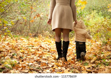 Mom and son walking in a park