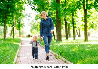 Mom and son walking in the park.