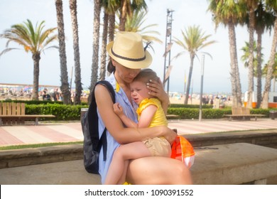 Mom soothes a small daughter. Family relationships theme.