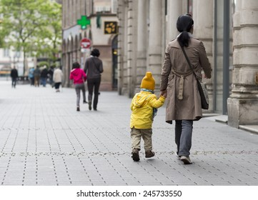 A mom taking a child to a kindergarten. Or this image suits fine as in theme 'back to school'