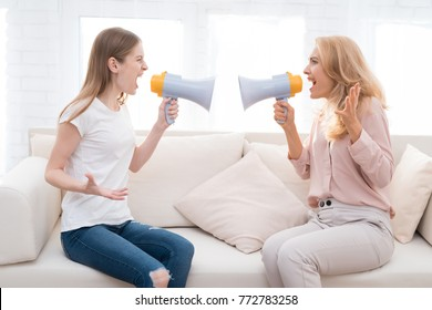 Mom and a teenage daughter are arguing with each other. They have a complex relationship. The daughter does not understand her mother. A woman is screaming at a girl.