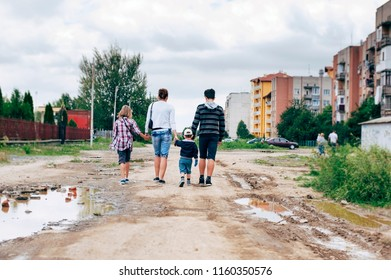 Mom with three children goes home on a bad road with holes. They spent their father, the husband at the station, who goes to work abroad and they are already bored for him
