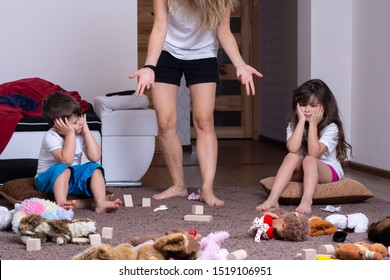Mom tired to tidy up the house. Child scattered toys. Mess in the house. Siblings