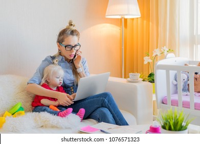 Mom with toddler working on laptop