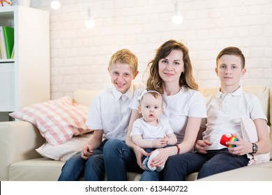 Mom with two children of twelve years and eleven months of age in the room