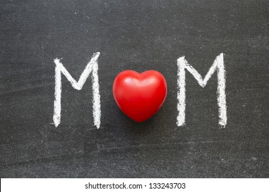 MOM word handwritten on the school blackboard with red heart as O letter