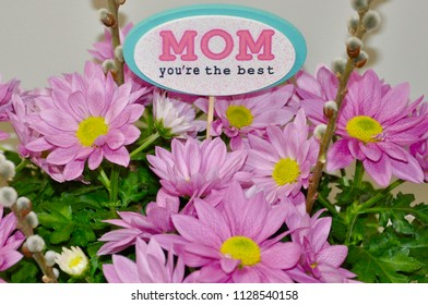 Mom you're the best sign between beautiful flowers