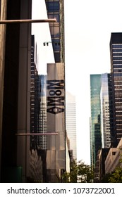 Moma sign at a New York Street