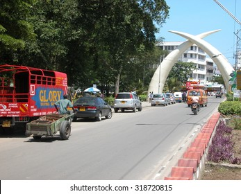 "MOMBASA, KENYA - November 22, 2007: Moi Avenue in Mombasa with the Mombasa ""Tusks"" portal. The memorial was built to commemorate the visit of Queen Elizabeth to Mombasa in 1952."
