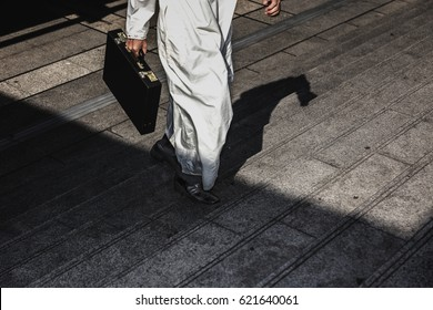 Moment Arab Businessman running fast upstairs. Horizontal outdoors shot,image leg walking up stairs in city to success,Space for copy text.