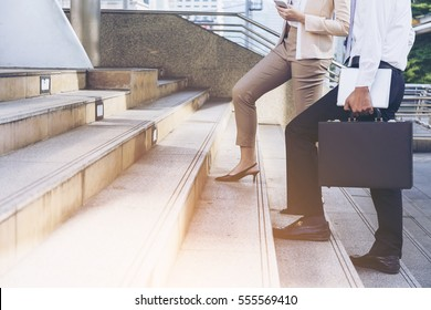 Moment Businessman running fast upstairs. Horizontal outdoors shot,image leg walking up stairs in city to success,Space for copy text.