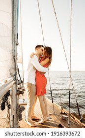 The moment of the marriage proposal, she said YES, the proposal on the yacht. A loving couple are kissing.