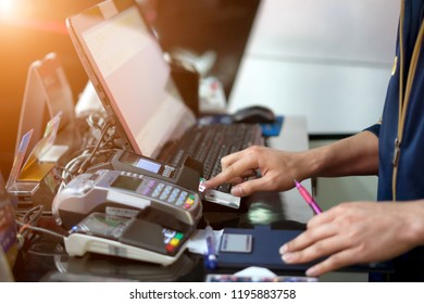 Moment of payment with a credit card through terminal.monochrome