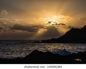 moment of peace and serenity at sunrise. Elephant arch on the island of Pantelleria, Italy