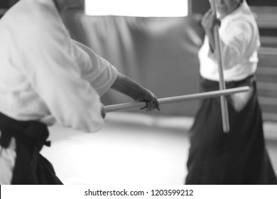 The moment of training combat in aikido with the use of a long wooden pole