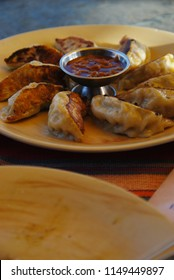 Momo is a type of South Asian dumpling; native to Bhutan, Tibet, Nepal, and the Ladakh, Sikkim, Assam and Darjeeling regions of India. It is similar to gyoza and jiaozi.