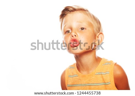 37ab64690e3 Portrait of cute little boy in orange sleeveless T-shirt isolated