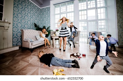 Moms and kids spending time in the living room