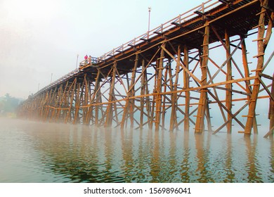 Mon brige Saphan Mon wooden bridge in the morning light, Winter Thailand traveling background.