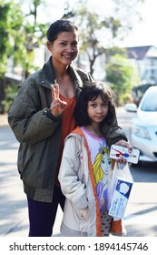 Mon and daughter with the cool morning to buy mask in Parichat345 Village. Pathumthani province, Thailand. Shot on January 14,2021.