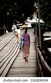 Mon people  on the wooden Mon bridge,Sangkhlaburi, Thailand
