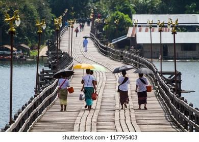 Mon people walking on the long wood bridge