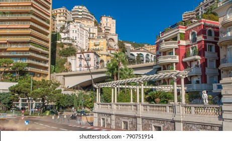 Monaco church Sainte Devote bridge principality mountain city state timelapse hyperlapse early morning. Sunny summer day. Traffic on the road