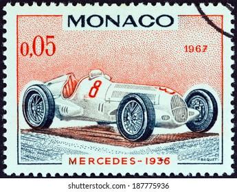 """MONACO - CIRCA 1967: A stamp printed in Monaco from the """"25th Grand Prix, Monaco"""" issue shows Mercedes Grand Prix racing car of 1936, winner of Monaco Grand Prix, circa 1967."""
