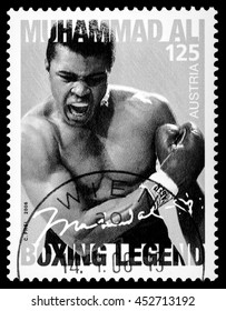 MONACO - CIRCA 2014: A postage stamp printed in Vienna Austria portraying an image of Muhammad Ali when he knocked out Sony Liston during a boxing match in 1964, circa 2006