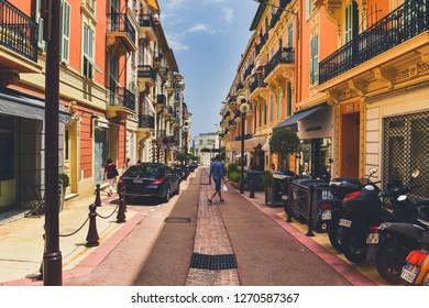 Monaco, Monaco - July 2, 2018. Narrow street in Monaco with buildings in both sides.