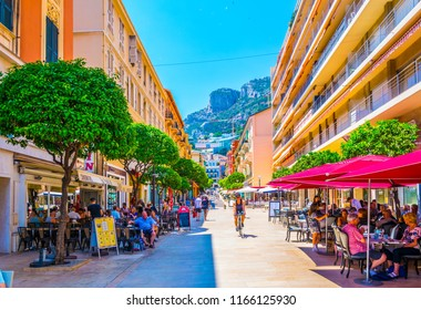 MONACO, MONACO, JUNE 17, 2017: People are strolling through a narrow street in the center of Monaco