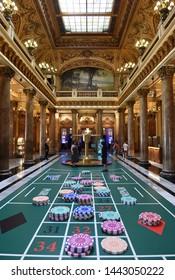 Monaco - June 20, 2019: Tourists inside the Monte Carlo Casino in Monaco.
