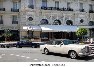 MONACO - MAY 07 2008:Luxury cars outside Hotel de Paris, 5 star luxury hotel.Hotel de Paris in Monte Carlo was seen in two James Bond films, Never Say Never Again and GoldenEye