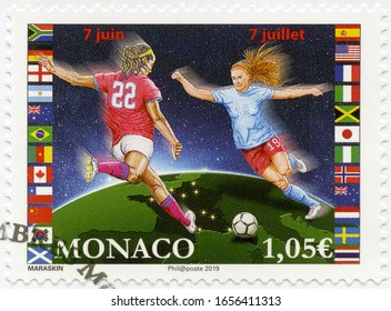 MONACO - MAY 29, 2019: A stamp printed in Monaco shows footballers, 2019 Football Women's World Cup, 2019