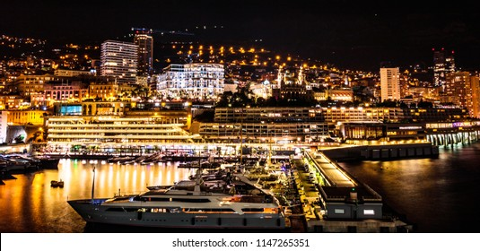 Monaco, Monte Carlo harbor in the French Riviera at night. Long exposure shot from the sea.