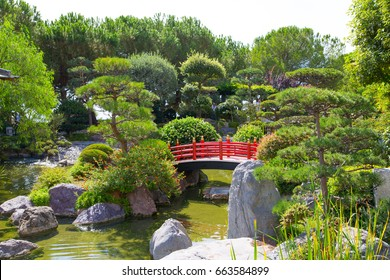 Monaco, Monte Carlo - September 17, 2016: Jardin Japonais, Japanese Garden view with residential buildings at the background.
