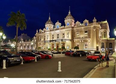 Monaco, Monte-Carlo, 04.09.2015: Casino Monte-Carlo in the night, Hotel de Paris, night illumination, luxury cars, players, tourists, fountain, cafe de paris, long exposure, summer, billioners