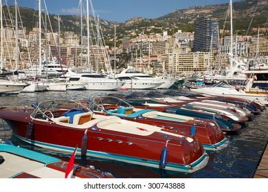 Monaco, Monte-Carlo, 25.09.2008: Yacht Show, Port Hercule, luxury yachts in harbor of Monaco, Etats-Uni, Piscine, Hirondelle, riva boats parking