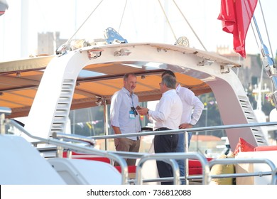 Monaco, Monte-Carlo, 27 September 2017: The yacht broker shows the yacht to the rich client on Yacht show, the richest people, cityscape, tenders, megayacht Jubilee, exhibition stands, exhibitors