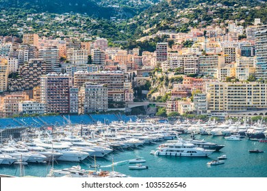 Monaco, Monte-Carlo, 28 May 2017: Port Hercule in time of carrying out race of the Grand Prix Formula 1, a lot of mega yachts, people by boats, parties with champagne, big screens, tribunes, azure
