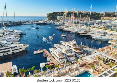 Monaco, Monte-Carlo, 29 September 2016: Timelapse of World Fair MYS Monaco Yacht Show, Port Hercules, luxury megayachts, many shuttles, taxi boat, presentations, Journalists, boat traffic, Azur water