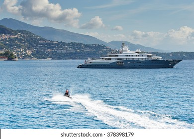 Monaco, Monte-Carlo, 4 sept 2015: Megayacht most expensive Radiant, the preparation of the yacht show MYS in September, sunny day, hotel Monte-Carlo Bay in background, Italy, Jet Ski, Lurssen, UAE