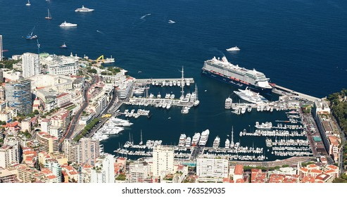 Monaco, Monte-Carlo, 9 September 2017: Port Hercule, view from La Turbie, aerial view at morning, sunrise, Mountains, Megayachts, a lot of boats, skyscrapers, hotel de Paris, casino