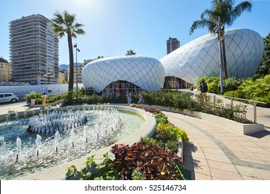 Monaco, Monte-Carlo, Casino square, 8 August 2016: Futuristic Fashion complex in the Monaco center, clothes boutiques, shopping, fountain