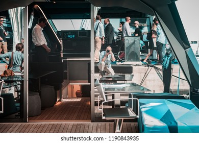 Monaco, Monte-Carlo, France, September 27, 2018: Moments from the annual Monaco Yacht Show, focusing on luxury power boats. Checkmate by Wally Yachts. Port Hercules, rich brokers, having fun.
