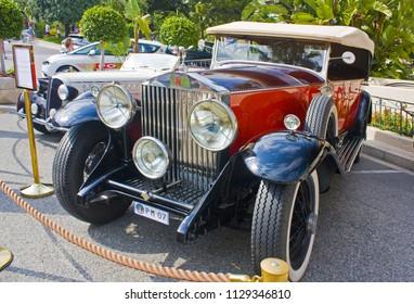Monaco, Monte-Carlo - June 22, 2018: Luxury retro cars next to Casino Cafe de Paris in Monaco