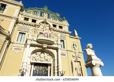 Monaco Monte-Carlo Opera House and casino west entrance with statue of composer Jules Massenet on blue sky day